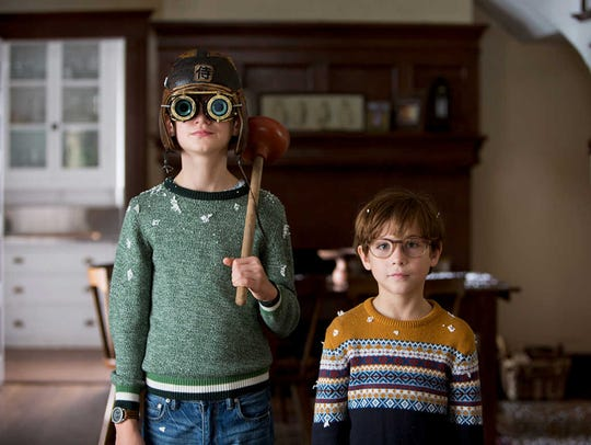 The cute kid in the googles, played by Jaeden Lieberher,