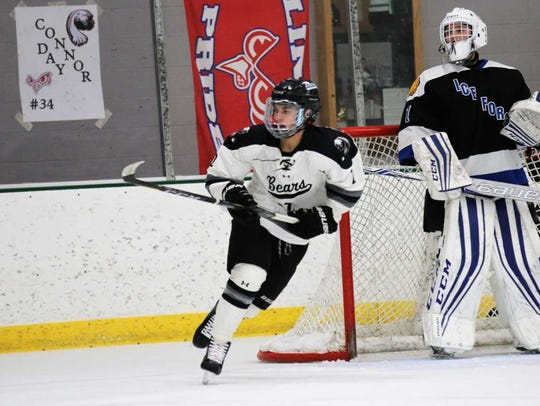 Andrew Butler skates up ice for the West Bend Ice Bears.