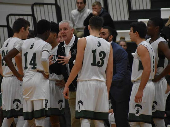 Coach Mike Thompson talks to his St. Joseph players during a home game last season.