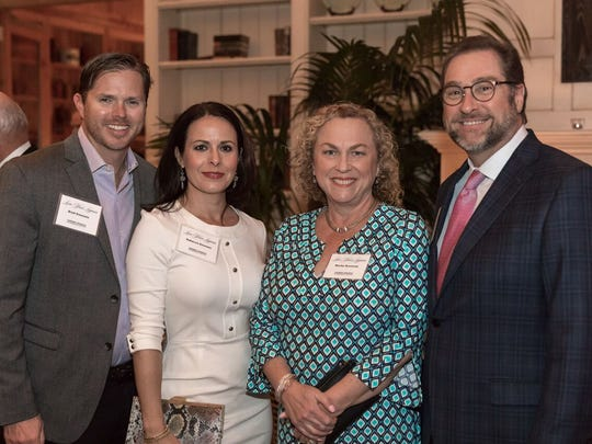 """Brad Emmons, left, Rebecca Emmons, Becky Rossway, and Brad Rossway at the """"Love Your Lagoon"""" gala at Quail Valley River Club in Vero Beach."""
