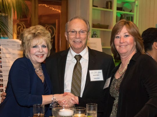 """HBOIF Treasurer Marjorie Raines, left, Harold Baker, and Eileen Hanley at the Feb. 2 """"Love Your Lagoon"""" gala at Quail Valley River Club."""