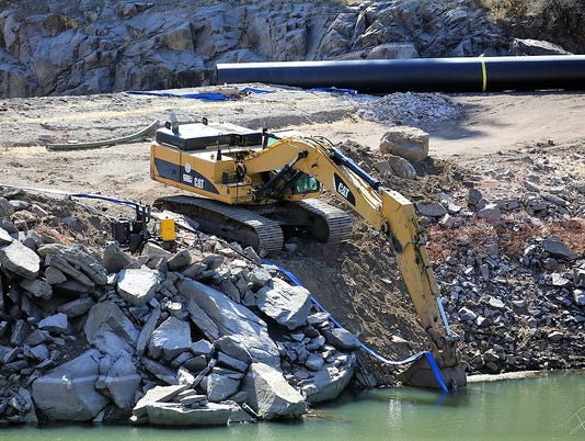 excavator with suction pipe bonito lake