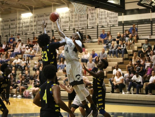 Mariner's Jahmel Myers fights for a rebound against