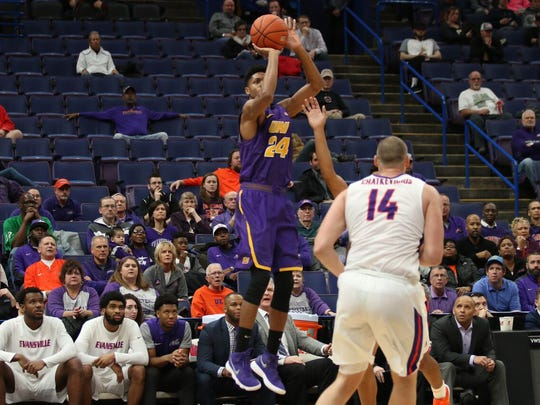UNI guard Isaiah Brown takes a shot during Thursday's game against Evansville at the MVC Tournament in St. Louis.