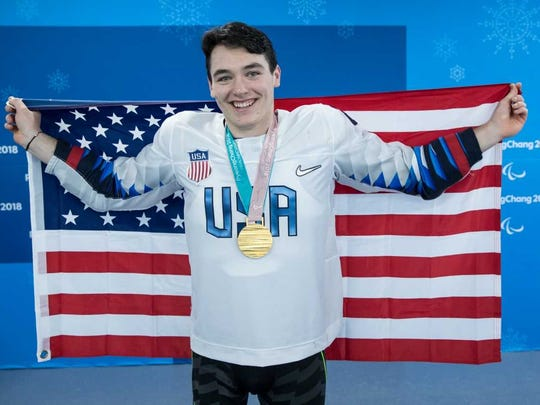 Franklin Lakes native Jack Wallace with his Paralympic sled hockey gold medal.