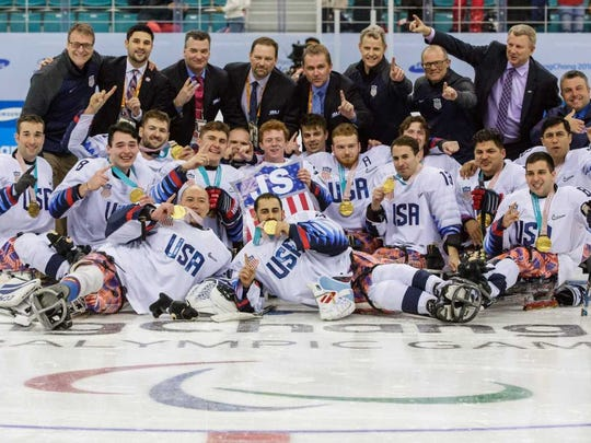 Jack Wallace, second from left, middle row, with coaches and teammates following their medal ceremony.