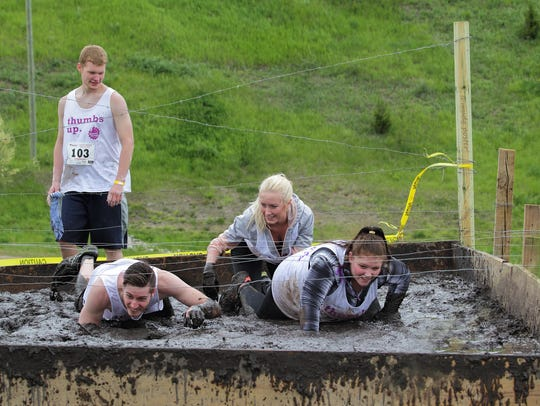 Runners crawled through mud during the 2017 Dash or