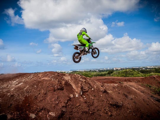 Lawrence Limtiaco, 12, is a motocross rider intent on getting faster and winning more. He is show here practicing for the spring 85cc MotoX series, which starts in July.