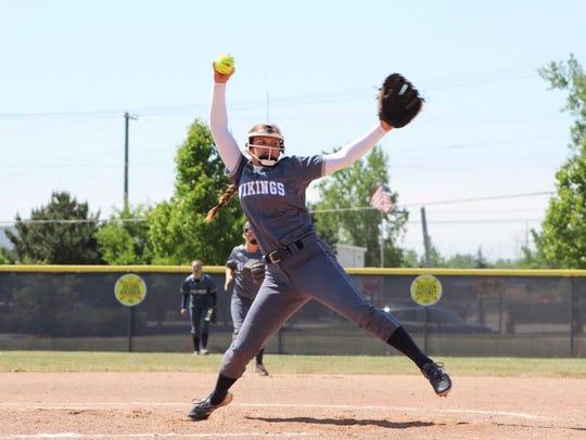 Marysville High School senior Paige Ameel throws in