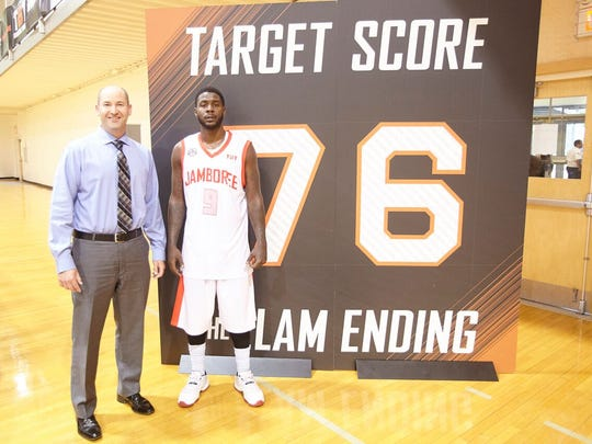 Nick Elam poses with Josh Selby, who made a game-winning shot under the Elam Ending on June 17, 2017.
