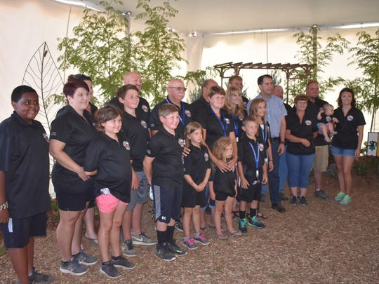 Gov. Scott Walker is joined by the Sternweis and Heiman families at Farm Technology Days in Wood County on July 11. The two families are co-hosting the event.