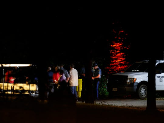Rescuers are shown at the scene on the night of the tragedy on Table Rock Lake.