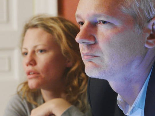 """This image released by Showtime shows Sarah Harrison, left, and Julian Assange in a scene from the documentary """"Risk."""""""