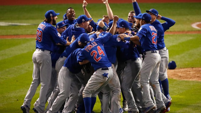 The Chicago Cubs celebrate Wednesday night after defeating the Cleveland Indians 8-7 in Game Seven of the 2016 World Series at Progressive Field in Cleveland, Ohio. The Cubs won their first World Series in 108 years.