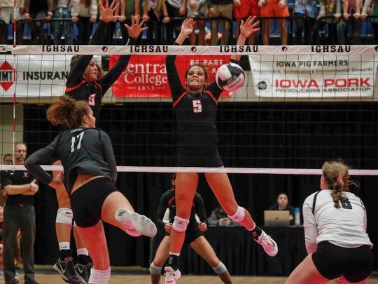West Des Moines Valley senior Cassie Yardley blocks
