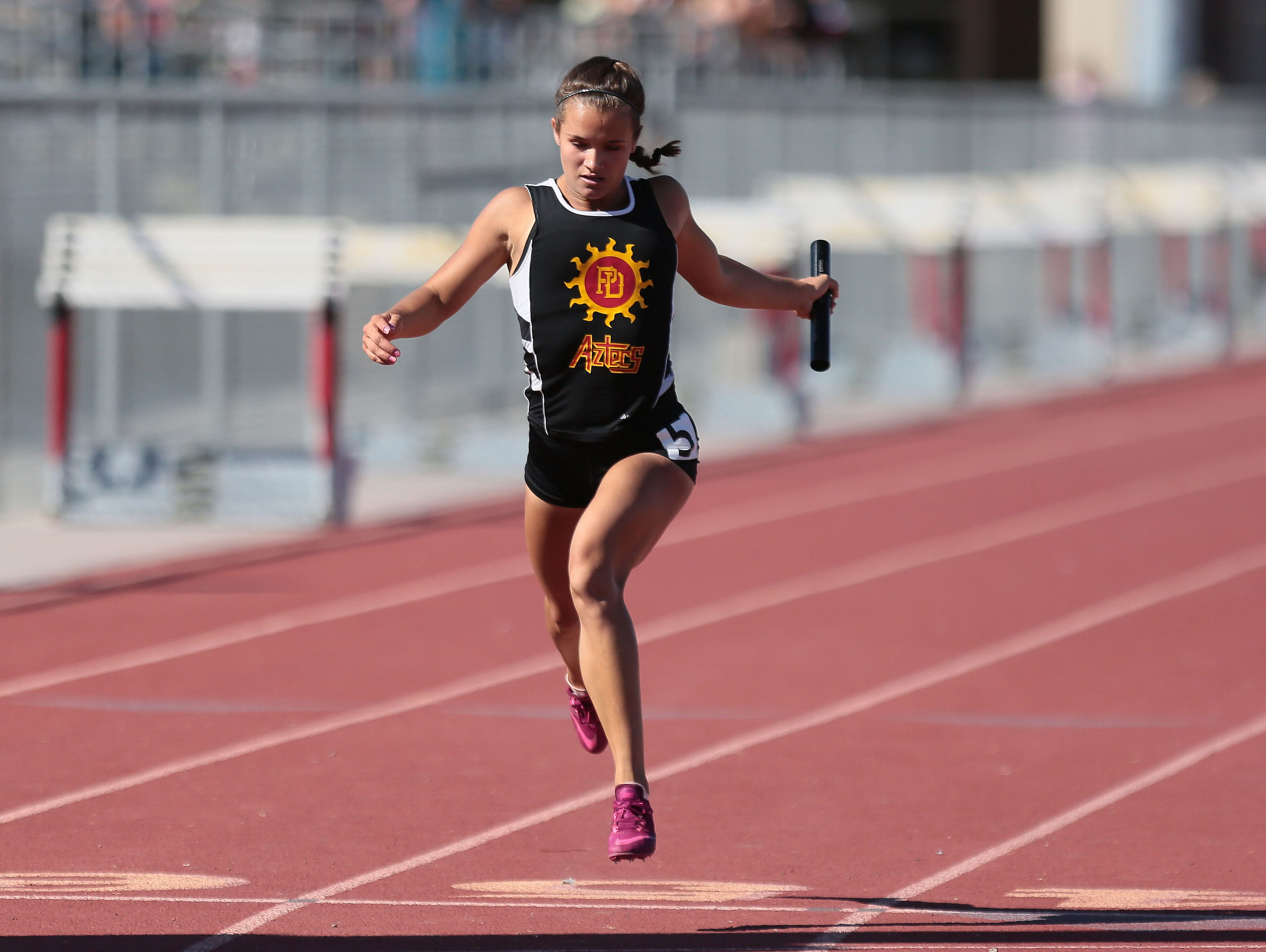 Palm Desert's Hailey Murdica crosses first for her relay team during a track meet with Xavier College Prep at Palm Desert High on Thursday, March 24, 2016