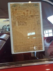 The original sales sticker with a list price of $3,254.70