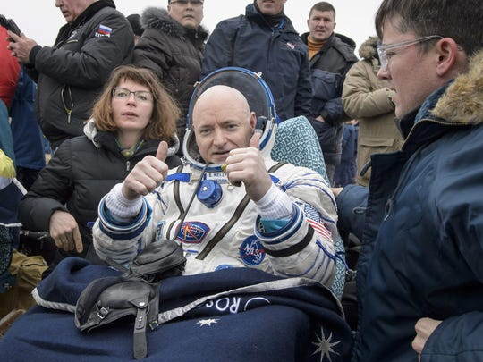 Scott Kelly of NASA rests in a chair outside of the Soyuz TMA-18M spacecraft in Kazakhstan after spending almost a year in space.