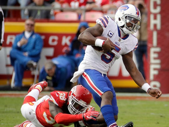 Buffalo Bills quarterback Tyrod Taylor (5) is tackled by Kansas City Chiefs defensive back Ron Parker (38) during the second half of an NFL football game in Kansas City, Mo., Sunday, Nov. 26, 2017. (AP Photo/Charlie Riedel)