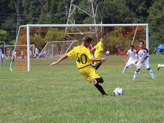 Fremont's Ayden Carter, 11, plays for the U-12 Columbus