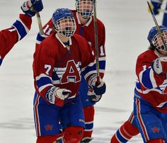 St. Cloud Apollo players celebrate a goal in the first period of their Section 6A championship game against St. Cloud Apollo on Thursday at the Municipal Athletic Complex.