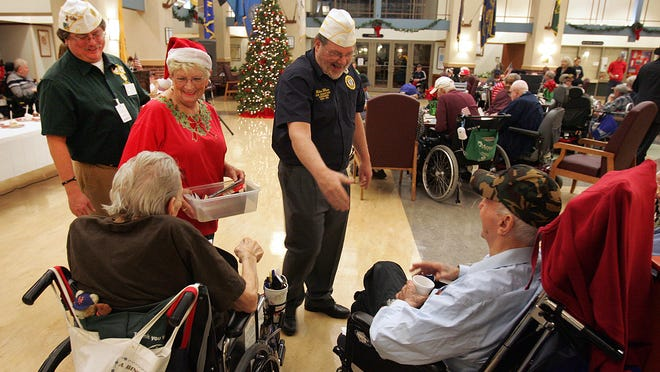 Mike Wilson center, a commander and member of the American Legion Post 401 at a recent Christmas party at ther Menlo Park Veterans Home in Edison on Thursday, December 4, 2014.