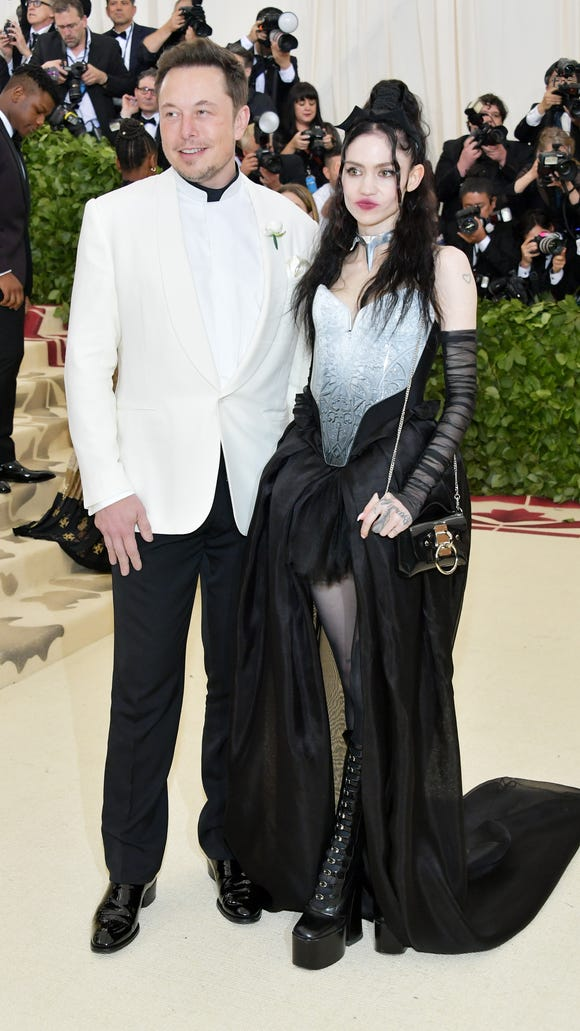Elon Musk and Grimes arrive at the Met Gala together,