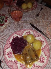Rouladen served with red cabbage, and potato dumplings with gravy from rouladens drippings.
