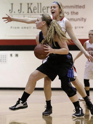 Emily Jacques of Oshkosh West looks to pass while being defended by Katie Sukanen of Neenah during Friday's game in Neenah.