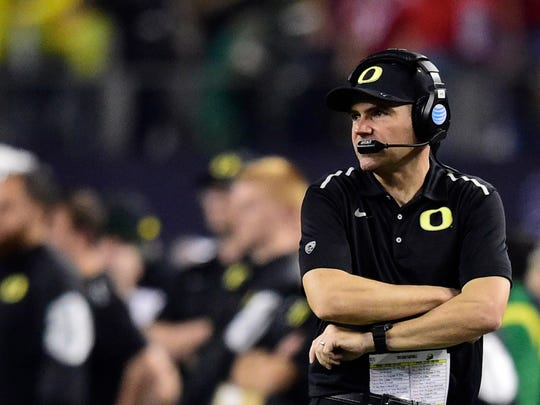 Oregon Coach Mark Helfrich and the Ducks fall to Ohio State in the College Football Playoff Championship at AT&T Stadium on Jan. 12 in Arlington, Texas.