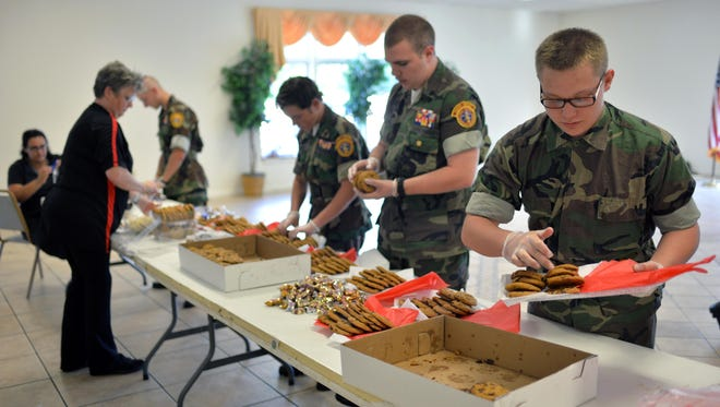 South Jersey Young Marine recruit Avery Thoden, 16, and Young Marine Sgt. Orion Richmond, 15 (from right), assemble trays of desserts, with other Young Marines, before giving them to local law enforcement, Monday, Aug. 29, 2016 in Vineland.