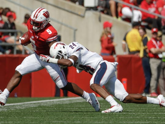Wisconsin's Chris James tries to run past Florida Atlantic's Zyon Gilbert during the second half of an NCAA college football game Saturday, Sept. 9, 2017, in Madison, Wis. Wisconsin won 31-14. (AP Photo/Morry Gash)