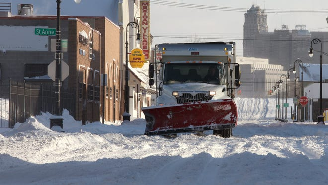 A snowplow makes it's way westbound on Bagley street in Southwest Detroit after the snowstorm hit the metropolitan Detroit area in Feb. 2015.