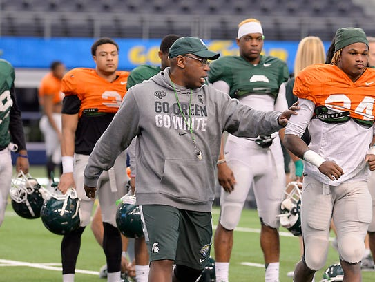 MSU assistant coach Harlon Barnett works with the defensive secondary as the Spartans practice for the upcoming Cotton Bowl at e AT & T Stadium in Arlington, TX Sunday 12/28/2014.