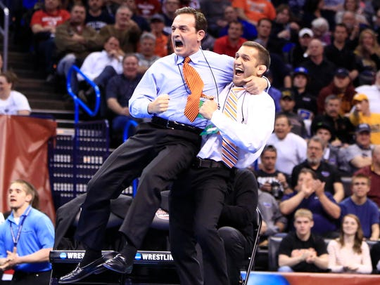 Oklahoma State head coach John Smith, left, needed