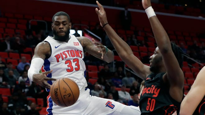 Willie Reed grabs a rebound Monday against Portland. Reed has played three games with the Pistons since being acquired in the Blake Griffin trade with the Clippers.