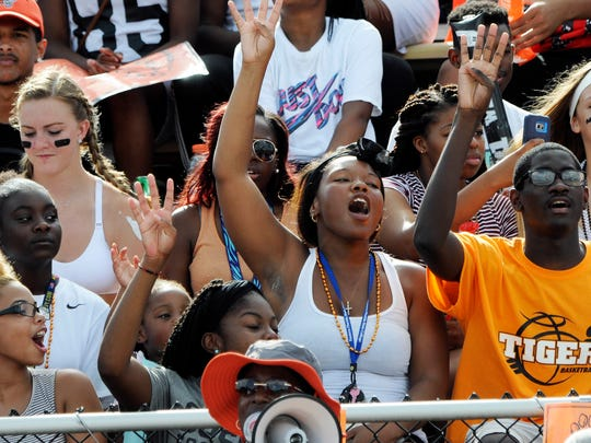 Fans cheer for the Cocoa Tigers during a game this season.