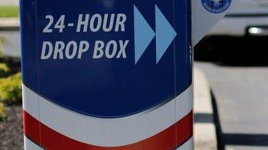 Drop box for ballots.