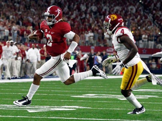 Sep 3, 2016; Arlington, TX, USA; Alabama Crimson Tide quarterback Jalen Hurts (2) runs for a touchdown past USC Trojans defensive back Chris Hawkins (4) during the second half at AT&T Stadium. Mandatory Credit: Tim Heitman-USA TODAY Sports