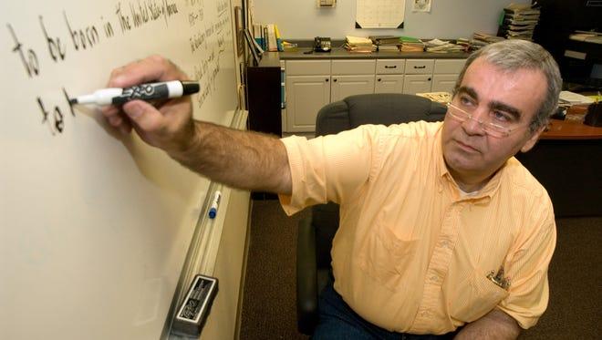 Radu Sebesiu teaches a United States citizenship class at Golden Gate Community Center in Phoenix in 2006.
