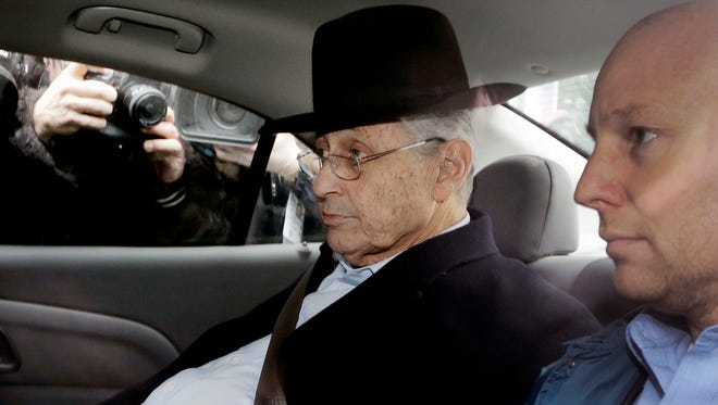 New York Assembly Speaker Sheldon Silver, center, is driven by federal agents to federal court, Thursday, Jan. 22, 2015 in New York. Silver was arrested Thursday on public corruption charges.