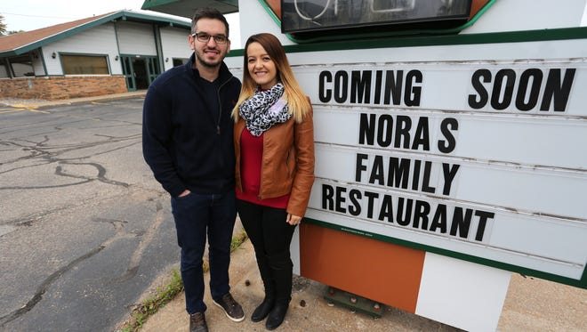 Alban and Nora Ismaili stand outside of what will be their new business, Nora's Family Restaurant on S. Central Avenue in Marshfield, on Monday, Oct. 5, 2015.