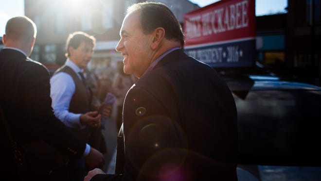 Republican presidential candidate Mike Huckabee leaves a campaign event at Inspired Grounds coffee on Sunday, Jan. 31, 2016, in West Des Moines.