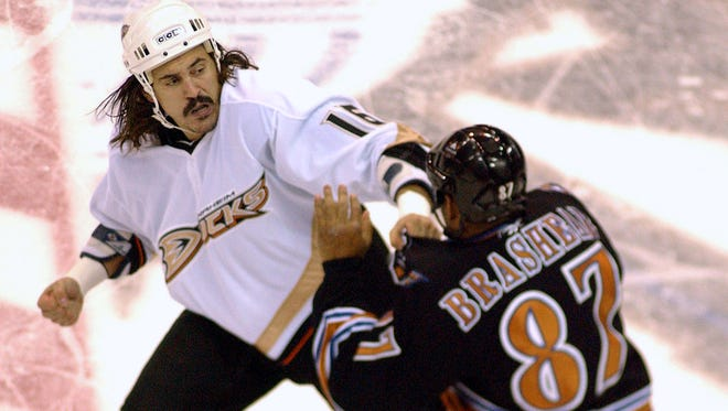 Anaheim's George Parros (16) and Washington's Donald Brashear (87) fight during an NHL game in 2006. (AP Photo/Linda Spillers)