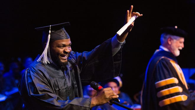 Savion Kirkland gives thanks after receiving his degree. Penn State York holds its fall commencement at the Pullo Family Performing Arts Center, Friday, December 16, 2016.