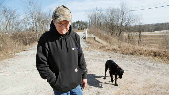 Brian Maas talks about hiking the trails with his dog Jessie near the Freedom Bridge Tuesday, February 14, 2017, in Delphi. Maas, who is from Lafayette, said the area seemed safe and a good place to hike with his dog. Police announced that searchers around 12:15 p.m. Tuesday had found two bodies nearby next to Deer Creek. Police said foul play is suspected, however, they would not say whether the bodies were those of missing Delphi teens Liberty German and Abigail Williams, both 13.