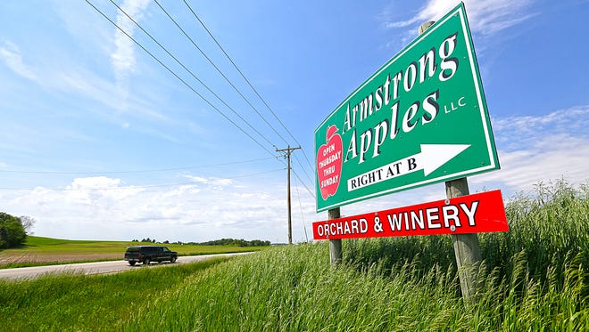 Wisconsin Department of Transportation has ordered Armstrong Apples Orchard and Winery to take down a sign at the intersection of Mitchell Road and State 45, near Wacousta. Wednesday June 7, 2017.