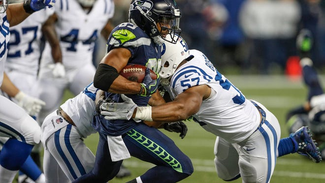 Indianapolis Colts inside linebacker Jon Bostic (57) takes down Seattle Seahawks wide receiver Doug Baldwin (89) at CenturyLink Field in Seattle on Sunday, Oct. 1, 2017.