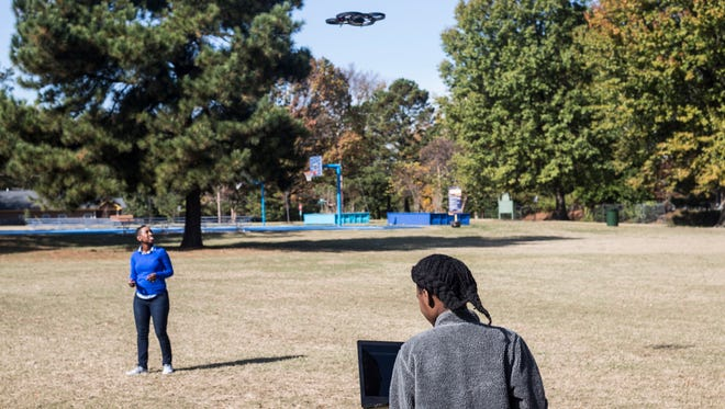 November 11, 2017 - Ariel Thompson, 12, controls a drone with a computer during a CodeCrew activity at Chandler Park in the Soulsville and Cummings area.