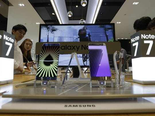 Galaxy Note 7 smartphones are displayed at Samsung's showroom in Seoul, South Korea, on Saturday. The company has told customers to stop using the devices after several dozen caught fire.